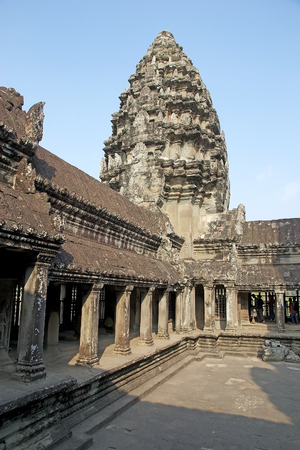 Details of the upper gallery and tower at Angkor Wat, Angkor, Siem Reap, Cambodia. Angkor Wat was first a Hindu later a Buddhist temple complex and the largest religious monument in the world. It was built in the first half of 12th century by the Khmer Ki photo