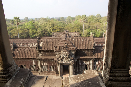 galley: View of the gallery and forest from the upper galley at Angkor Wat, Angkor, Siem Reap, Cambodia. Angkor Wat was first a Hindu later a Buddhist temple complex and the largest religious monument in the world. It was built in the first half of 12th century b