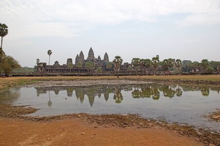 Angkor Wat, Angkor, Siem Reap, Cambodia. Angkor Wat was first a Hindu later a Buddhist temple complex and the largest religious monument in the world. It was built in the first half of 12th century by the Khmer King Suryavarman in the capital Khmer empire photo