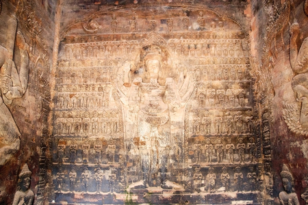 bas relief: The bas relief on the interior wall of the cental tower at Prasat Kravan temple ruins, Angkor, Siem Reap, cambodia. Eight armed Vishnu surrounded by tiers of worshippers. Prasat Kravan is small 10th century temple consisting of five reddish brick towers.  Stock Photo