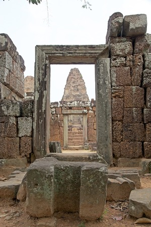 tiers: East Mebon temple ruins, Angkor, Siem Reap, Cambodia. East Mebon temple was built in the second half of 10th century. Built in the general style of Pre Rup, East Mebon has two enclosing and three tiers.