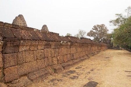 tiers: The wall at the East Mebon temple ruins, Angkor, Siem Reap, Cambodia. East Mebon temple was built in the second half of 10th century. Built in the general style of Pre Rup, East Mebon has two enclosing and three tiers.