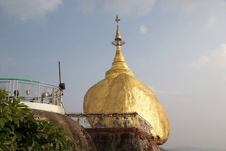 ices: Kyaiktiyo Pagoda Golden Rock Kyaiktiyo Myanmar or Burma. Kyaiktiyo Pagoda anche known as Golden Rock is a well known Buddhist pilgrimage site in the Mon State Myanmar. It is a small pagoda built 73 m on the top of a granite boulder covered with gold leave
