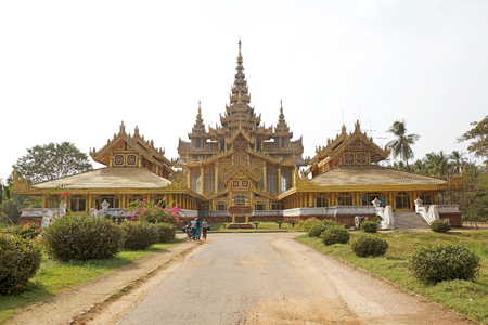 spl: Tourists are going to visit the Bago Golden Palace, Bago, Myanmar. The Golden Palace is the reconstruction of the original Royal palace from the secon half of 16th century. It was rebuilt following the original design and give a good impression of the spl Editorial
