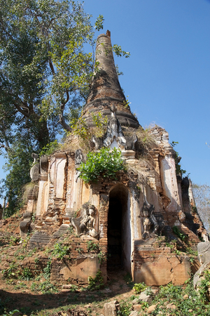 mention: Ancient pagoda at the Shwe Inn Dain Pagoda complex, Indein village, Inle Lake, Myanmar. Shwe Inn Dain and its 1054 pagodas history is shrouded in mystery: Myanmar historical records make no mention of its construction. One theory puts its beginnings at 30