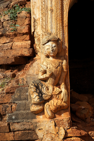 mention: Details of the sculpture at the entrance of one pagoda at the Shwe Inn Dain Pagoda complex, Indein village, Inle Lake, Myanmar. Shwe Inn Dain and its 1054 pagodas history is shrouded in mystery: Myanmar historical records make no mention of its constructi Stock Photo