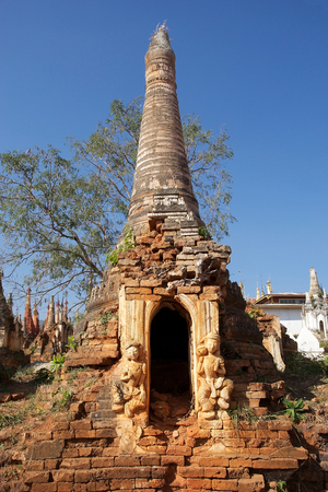 Mention: Architecture details of one pagoda at the Shwe Inn Dain Pagoda complex, Indein village, Inle Lake, Myanmar. Shwe Inn Dain and its 1054 pagodas history is shrouded in mystery: Myanmar historical records make no mention of its construction. One theory puts  Stock Photo