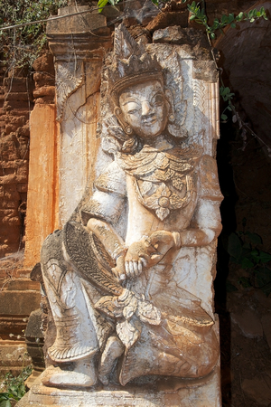 mention: Sculpture at the entrance of one pagoda at the Shwe Inn Dain Pagoda complex, Indein village, Inle Lake, Myanmar. Shwe Inn Dain and its 1054 pagodas history is shrouded in mystery: Myanmar historical records make no mention of its construction. One theory  Stock Photo