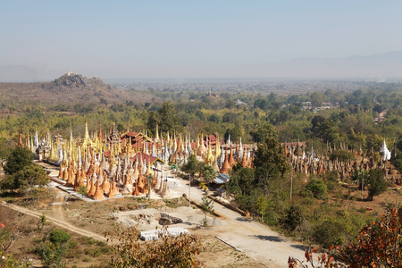 Mention: View of the Shwe Inn Dain Pagoda complex, Indein village, Inle Lake, Myanmar. Shwe Inn Dain and its 1054 pagodas history is shrouded in mystery: Myanmar historical records make no mention of its construction. One theory puts its beginnings at 300-200 BC