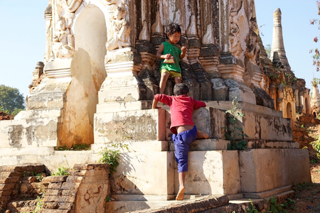 mention: Burmese children are playing among the pagodas at the Shwe Inn Dain Pagoda complex, Indein village, Inle Lake, Myanmar. Shwe Inn Dain and its 1054 pagodas history is shrouded in mystery: Myanmar historical records make no mention of its construction. One  Editorial
