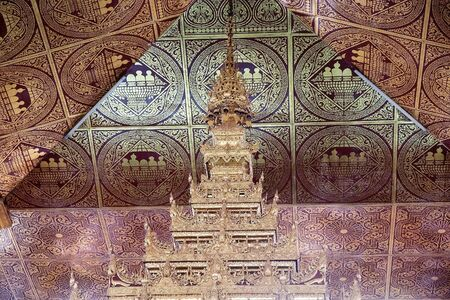 daw: Architecture details of the ceiling of the Phaung Daw Oo Pagoda, Lake Inle, Myanmar. Phaung Daw Oo Pagoda is a noteble buddhist site in Myanmar or Burma. The pagoda houses five small gilded images of Buddha, wich have been covered in gold leaf to the poin Editorial
