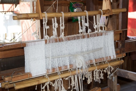 handloom: Hand loom at the workshop on the Lake Inle, Myanmar, to weaving the lotus thread. Lotus textile is one of the most precious in the world. Needs  many week to prepare the lotus febre and weaving just one scarf Stock Photo