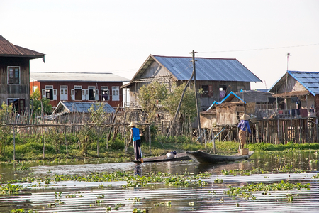 traditional goods: Lifestyle on the Lake Inle, Shan State, Myanmar. Traditional burmese boats used to carry people and goods along the channel on the Lake Inle. Inle Lake is a freshwater lake located in the Nyaungshwe Township of Shan State, Myanmar. It is the second larges