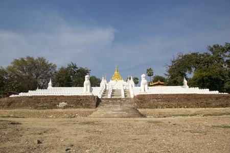 begun: The stairway leading up from the Irrawaddy river banks to MIngun Pahtodawgy  Mingun, Myanmar. The Mingun Pahtodawgy is an incomplete stupa. The ruins are the remains of a massive construction project begun by King Bodawpaya in 1790.