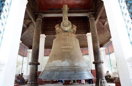 Pilgrims are visiting the Mingun bell, Mingun, Myanmar. Casting of the bell starting in 1808 and was finished in 1810. The weight of the bell is 55.555 viss, one viss is 1,63293 kg. The weight of the bell and its mnemonic words are written on the surface  Stock Photo