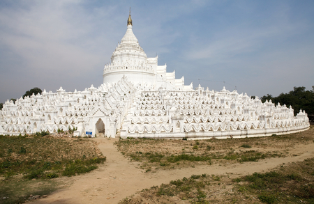 Hsinbyume Pagoda also known as Myatheindan Pagoda view. The Hsinbyume is a large white pagoda on the northern side of Mingun, Sangaing Region, Myanmar, on the western bank of Irrawaddy river. The pagoda is modeled on the Phisical description of the Buddhi