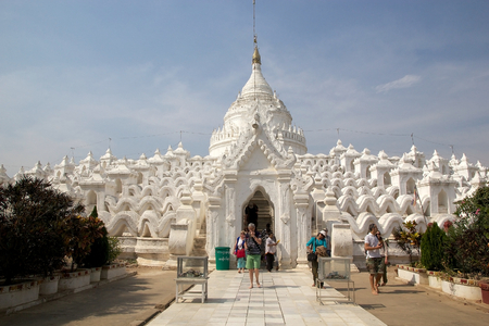 phisical: Tourist are visiting the Hsinbyume Pagoda also known as Myatheindan Pagoda. The Hsinbyume is a large white pagoda on the northern side of Mingun, Sangaing Region, Myanmar, on the western bank of Irrawaddy river. The pagoda is modeled on the Phisical descr Editorial