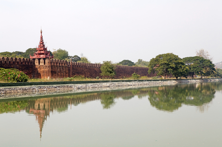moat wall: The bastion at the Mandalay Palace wall, Mandalay, Myanmar. Mandalay Palace is the last royal palace of the last Burmese monarchy. The palace was constucted between 1857 and 1859. The palace is inside a walled fort surrounded by a moat and it is at the ce