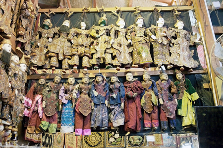 forsale: Traditional marionettes with traditional clothes are for sale in a shop in Mandalay, Myanmar