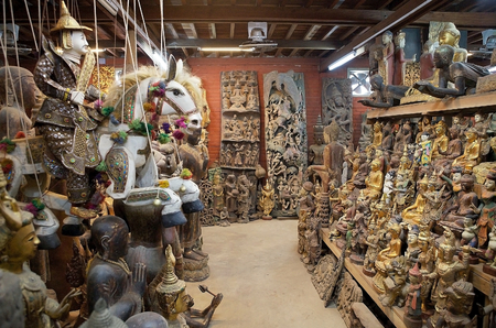 forsale: Traditional marionettes and other wooden object are for sale in a shop in Mandalay, Myanmar Editorial
