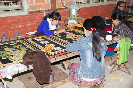 burmese: Burmese women are making a burmese traitional tapestry at the workshop in Mandalay, Myanmar