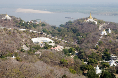 monastic: Sagaing Hills, Myanmar, with the Ayeyarwady river . Sagaing with numerous Buddhist monasteries is an important religious and monastic center.