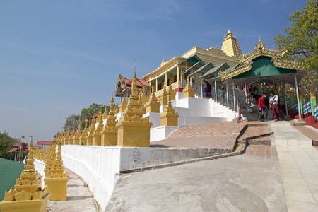 sone: Tourists are going to visit the Sone Oo Pone Nya Shin Pagoda, Nga Pa hill, Sagaing hill, Sagaing, Myanmar. Sone Oo Pone Nya Shin Pagoda lies on the top of Nga Pa hill, one of the 37 hilltop of Sagaing Hills. It was built in 674. Editorial