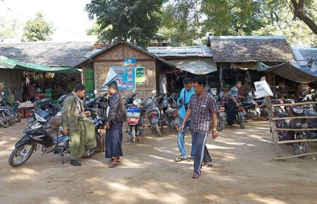 burmese: Burmese people along the street at the Nyaung U village, Bagan, Myanmar.
