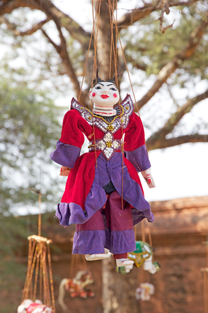marionette: Burmese marionette with traditional clothes for sale outside the Dhammayangyi temple,Bagan, Myanmar. Stock Photo
