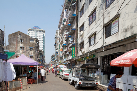 milion: Narrow street in downtown Yangon, Myanmar. Yangon, also known as Rangoon, is a former capital of Myanmar and the capital of Yangon region. It is the Countrys largest city and the most important commercial centre, with a population over five milion Editorial