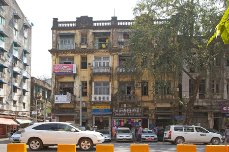 milion: Old building in downtown Yangon, Myanmar. Yangon, also known as Rangoon, is a former capital of Myanmar and the capital of Yangon region. It is the Countrys largest city and the most important commercial centre, with a population over five milion
