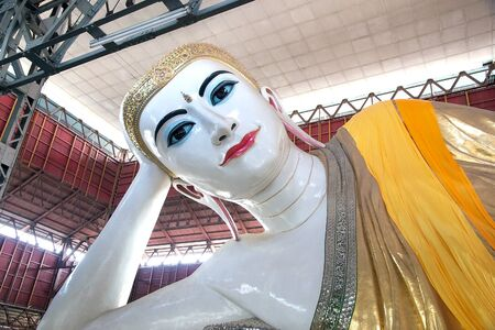 The giant reclining Buddha at the Chaukhtatgyi Buddha Temple, Yangon, Myanmar. The temple houses one of the most revered reclining Buddha in the Country. The Buddha image was 66 metres long and one of the largest in Myanmar. The construction began in 1899