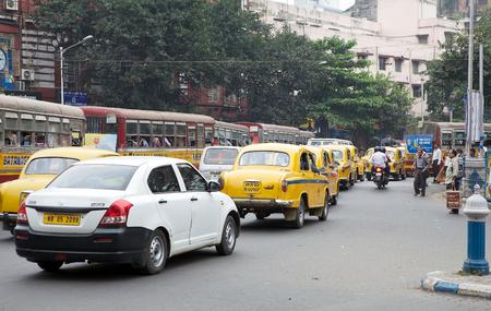 kolkata: Urban scene in Kolkata, West Bengal, India. Traffic along the street in Kolkata.