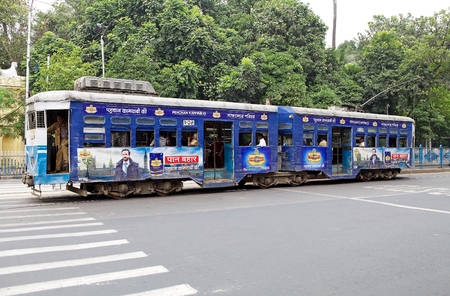 electric tram: Tram along the street in Kolkata, West Bengal, India. Kokata tram is a tram system run by Calcutta tramway company. It is currently the only operating tram network in India and the oldest operating electric tram in Asia,running since 1902.