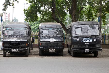 kolkata: Kolkata police buses along the street in Kolkata, India. The Kolkata Police Force is one of the six police forces of the Indian State of West Bengal. Kolkata Police has the task of policing the metropolitan area of Kolkata.