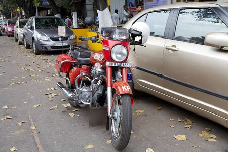 enfield: Kolkata police motorcycle Royal Enfield along the street in Kolkata, India. The Kolkata Police Force is one of the six police forces of the Indian State of West Bengal. Royal Enfield was the name under wich the Enfield Cycle Company, founded in 1893, made