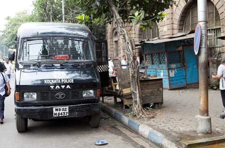 policing: Kolkata police bus along the street in Kolkata, India. The Kolkata Police Force is one of the six police forces of the Indian State of West Bengal. Kolkata Police has the task of policing the metropolitan area of Kolkata. Editorial
