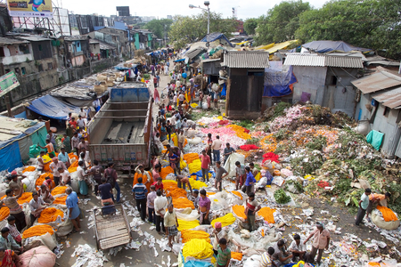howrah: View of the flower market in Kolkata, West Bengal, India. The Mullik Ghat, or Mallik Ghat, is near the southeast end of Howrah Bridge. The flower market is fascinatingly colorful virtually 24 hours a day.