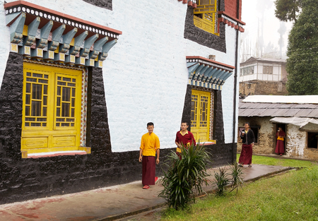 robes: Buddhist monks in traditional robes at the Sanghak Choeling Monastery, Sikkim, India, The monastery was founded in 1649 by Lama Lhatsun Chenpo Namkha Jigmee one of the three pioneer Lamas in Sikkim. Later was rebuilt in 1714. Sanghak Choeling means the la Editorial