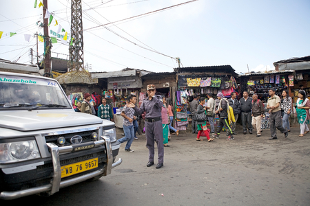 darjeeling: Darjeeling, West Bengal, India. Urban scene: traffic policeman and people along the street.