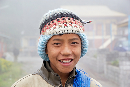 inhabit: Sikkimese young man portrait, Sikkim, India. Sikkimese people inhabit the Indian State of Sikkim. The indigenous people of Sikkim consist of the descendants of Buddhist who arrived from Tibet in the 15th century Editorial