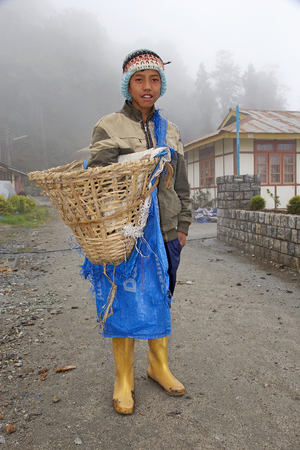 inhabit: Sikkimese young man, Sikkim, India. Sikkimese people inhabit the Indian State of Sikkim. The indigenous people of Sikkim consist of the descendants of Buddhist who arrived from Tibet in the 15th century Editorial