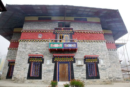 ecclesiastical: Details of the decorated facade of one side of the Labrang Gompa, Sikkim, India. It is a octagonal shape gompa along the road to Gagtok. The gompa is a Buddhist ecclesiastical fortification.