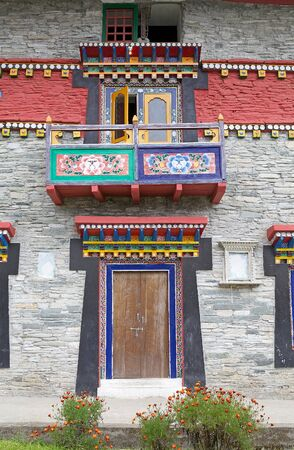 ecclesiastical: Details of the decorated door and balcony at the Labrang Gompa, Sikkim, India. It is a octagonal shape gompa along the road to Gagtok. The gompa is a Buddhist ecclesiastical fortification.