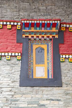 ecclesiastical: Details of the decorated window at the Labrang Gompa, Sikkim, India. It is a octagonal shape gompa along the road to Gagtok. The gompa is a Buddhist ecclesiastical fortification. Stock Photo