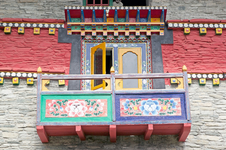 gompa: Decorated balcony at the Labrang Gompa, Sikkim, India. It is a octagonal shape gompa along the road to Gagtok. The gompa is a Buddhist ecclesiastical fortification. Stock Photo