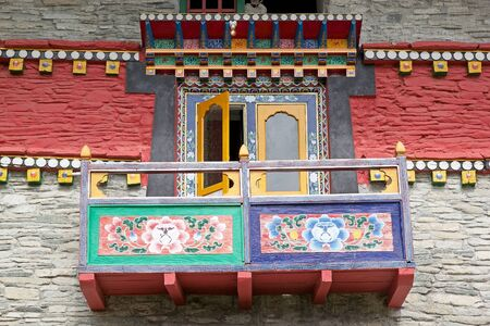 ecclesiastical: Details of the decorated balcony at the Labrang Gompa, Sikkim, India. It is a octagonal shape gompa along the road to Gagtok. The gompa is a Buddhist ecclesiastical fortification. Stock Photo
