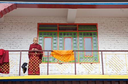 sectarian: Buddhist monk with traditional robes at the Rumtek Monastery, Sikkim, India. Rumtek Monastery is a gompa located near gangtok, capital of Indian state of Sikkim. It is a focal point of the sectarian tensions within the Karma Kangyu school of Tibetan Buddh Editorial