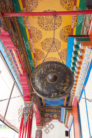 sectarian: Ritual gong at the Rumtek Monastery, Sikkim, India. Rumtek Monastery is a gompa located near gangtok, capital of Indian state of Sikkim. It is a focal point of the sectarian tensions within the Karma Kangyu school of Tibetan Buddhism that caracterize the