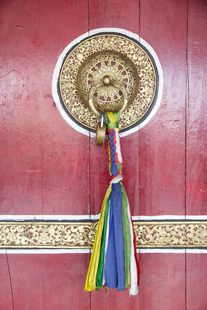 Details of the door at the Rumtek Monastery, Sikkim, India. Rumtek Monastery is a gompa located near gangtok, capital of Indian state of Sikkim. It is a focal point of the sectarian tensions within the Karma Kangyu school of Tibetan Buddhism that caracter Stock Photo
